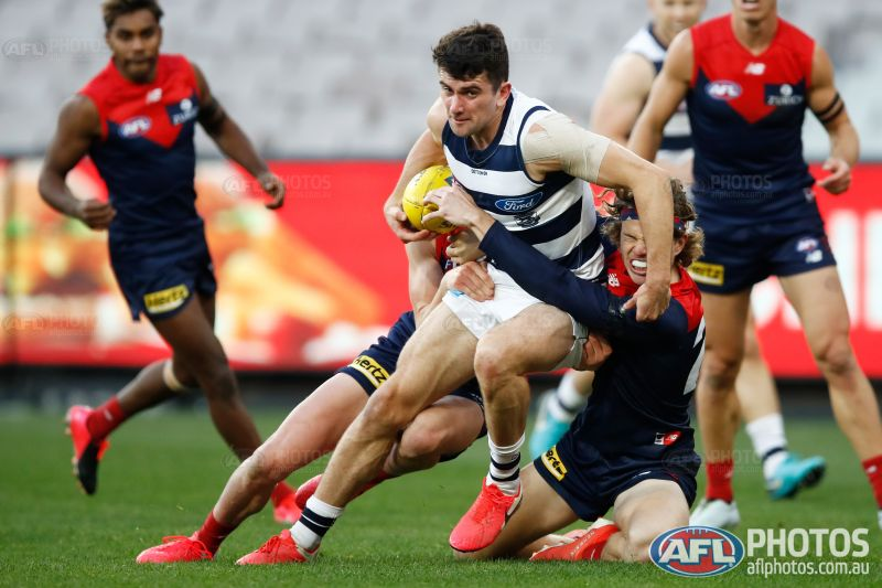 O'Connor muscles his way through. Photo: AFL Photos.