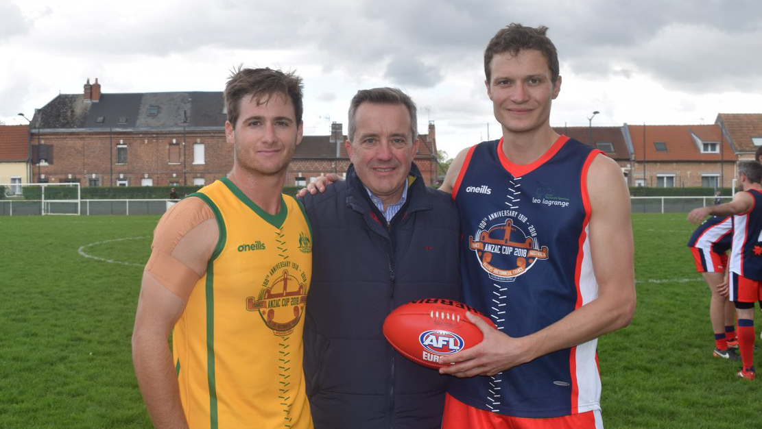 McClusky pictured with the Australian and French national team captains at AFL Europe's 2018 ANZAC Cup.